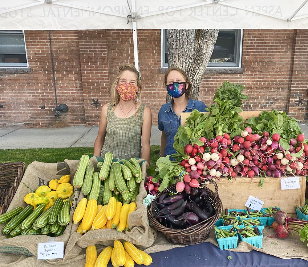 Mariah Foley and Dara Unger with a bounty of vegetables from ACES at Rock Bottom Ranch.
