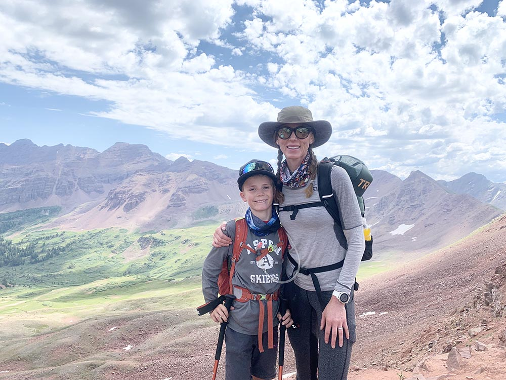Atop West Maroon Pass - eight-year-old Aiden Haynie who crushed his first Aspen/C.B. hike alongside his mom, Lyndsey Haynie.