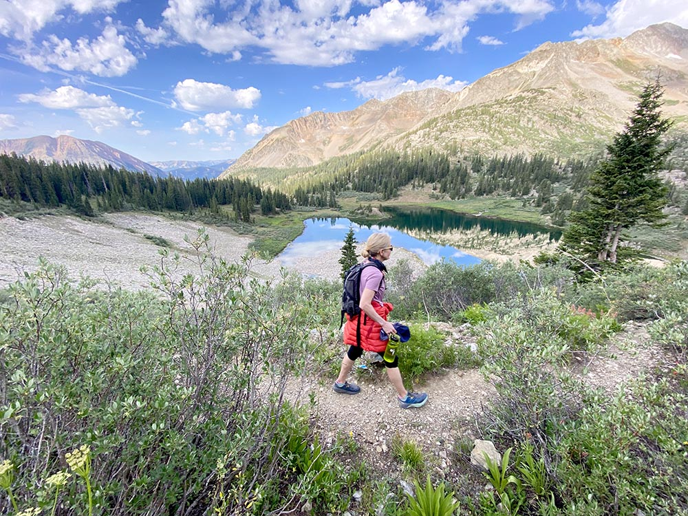 Kathy Kroger hikes high above Copper Lake along the East Maroon Pass trail towards Aspen.