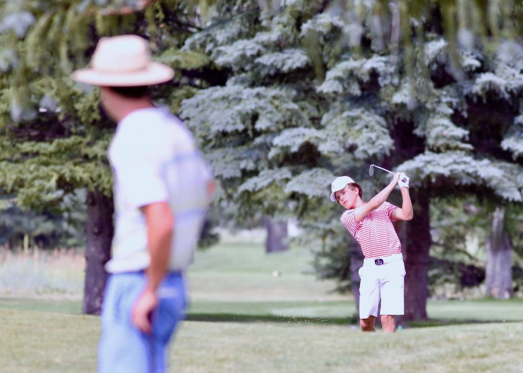 Aspen High School junior Nic Pevny makes his approach shot on the 18th hole during golf tryouts on Tuesday, Aug. 4, 2020, at Aspen Golf Club. (Photo by Austin Colbert/The Aspen Times)