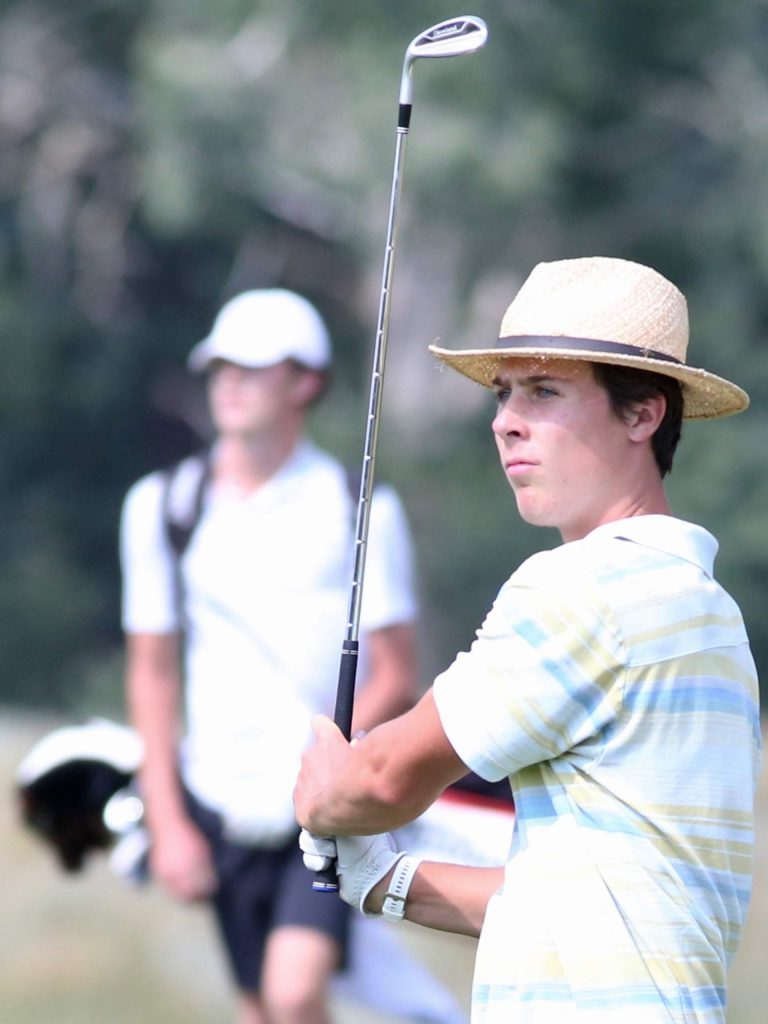 Cole Kennedy eyes his shot during Aspen High School boys golf tryouts on Tuesday, Aug. 4, 2020, at Aspen Golf Club. (Photo by Austin Colbert/The Aspen Times)