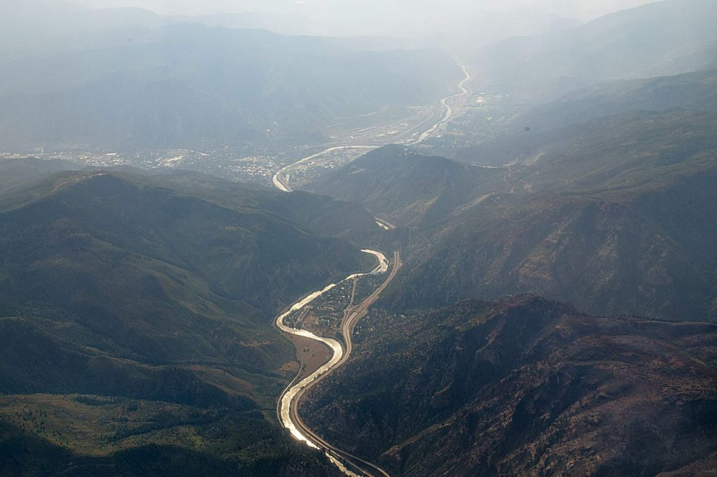 The Colorado River divides Glenwood Canyon slurry and a burn scar on the ridge from the Grizzly Creek Fire on Monday, August 24, 2020. (Kelsey Brunner/The Aspen Times)