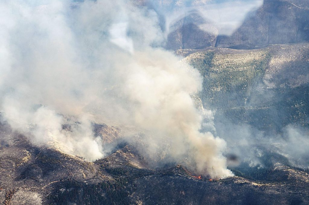 Flames and smoke from the Pine Gulch Fire burns along a ridge line on Monday, August 24, 2020. (Kelsey Brunner/The Aspen Times)