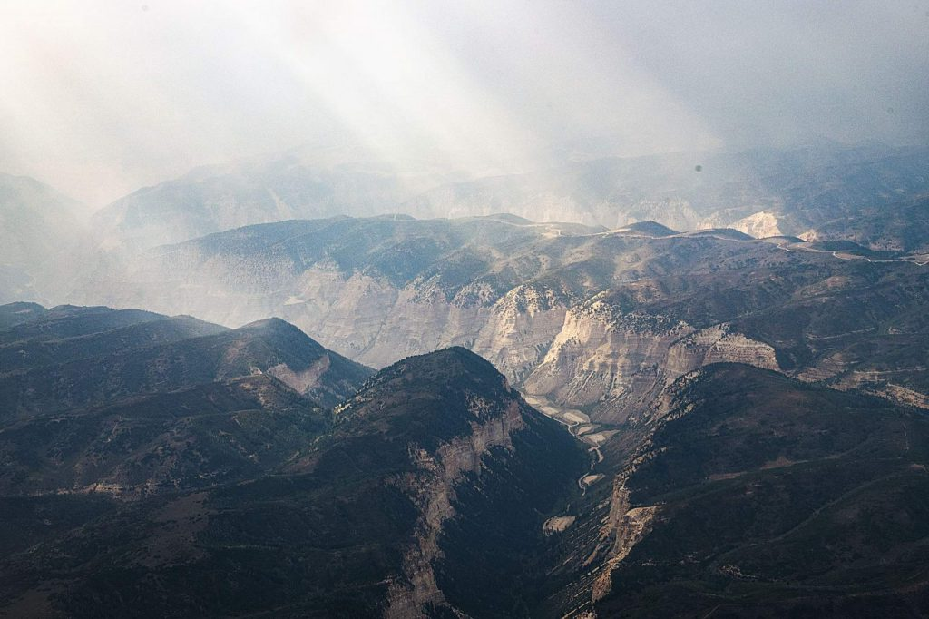 Sunlight streams through the smoky air to light on Roan Plateau near the Pine Gulch Fire on Monday, August 24, 2020. (Kelsey Brunner/The Aspen Times)