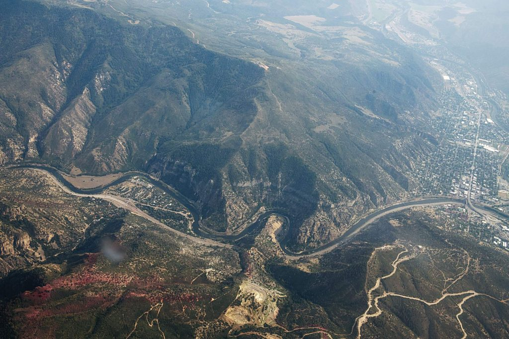 The Colorado River divides Glenwood Canyon slurry on the ridge from the Grizzly Creek Fire on Monday, August 24, 2020. (Kelsey Brunner/The Aspen Times)