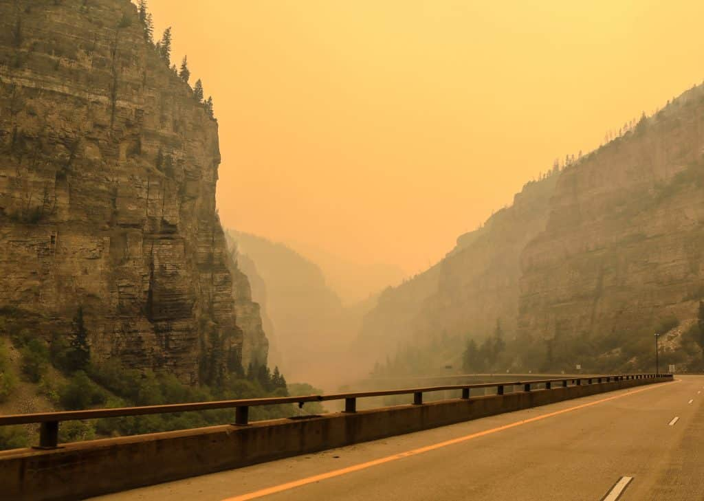 Smoke sits low in Glenwood Canyon Sunday near Glenwood Springs. Interstate 70 remains closed.