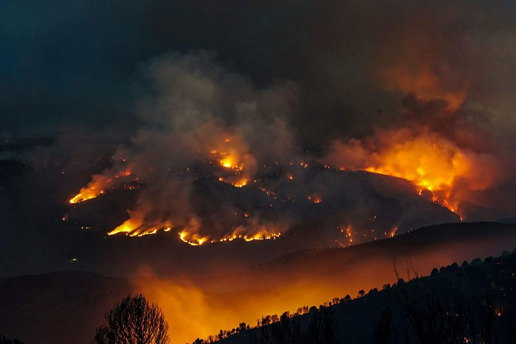 The Grizzly Creek Fire glows overnight. The blaze in Garfield and Eagle Counties is no longer the highest-priority fire in the country, though Interstate 70 remains closed through Glenwood Canyon.