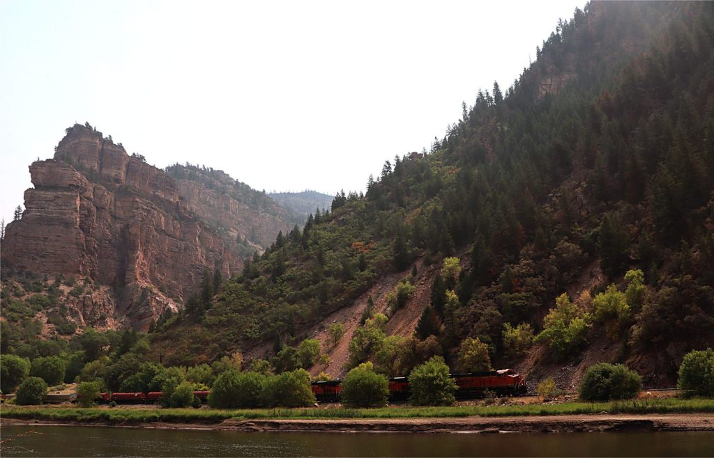 A Burlington Northern Santa Fe train goes through Glenwood Canyon on Sunday. The canyon tracks, which are owned by Union Pacific, reopened to traffic last week.