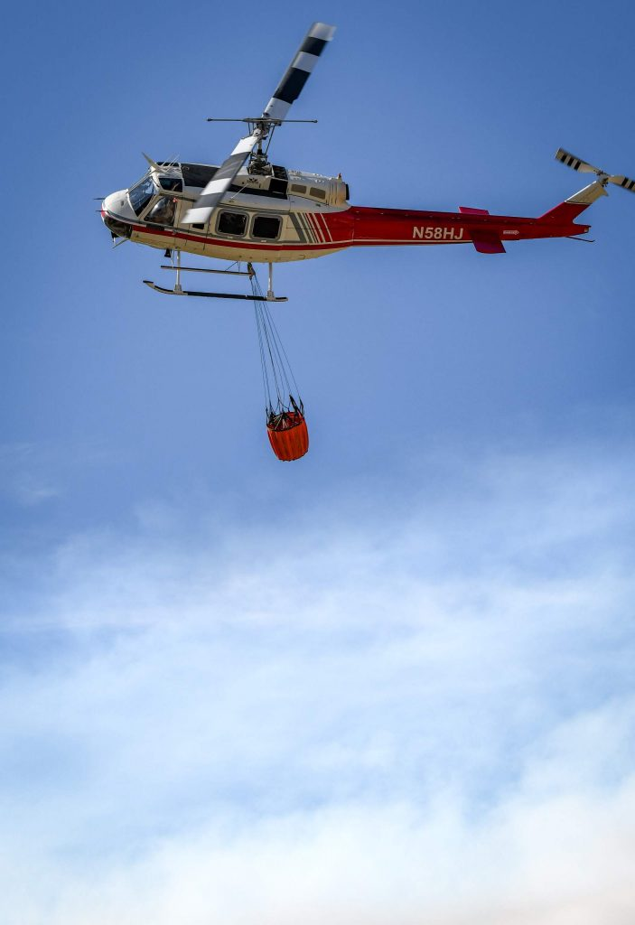 A Huey helicopter lifts off from the Glenwood Springs Municipal Airport after refueling and returning to continue fighting the Grizzly Creek Fire late Thursday afternoon.