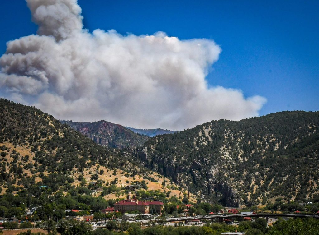Smoke from the Grizzly Creek Fire billows from Glenwood Canyon as the fire continues to grow on Thursday afternoon.