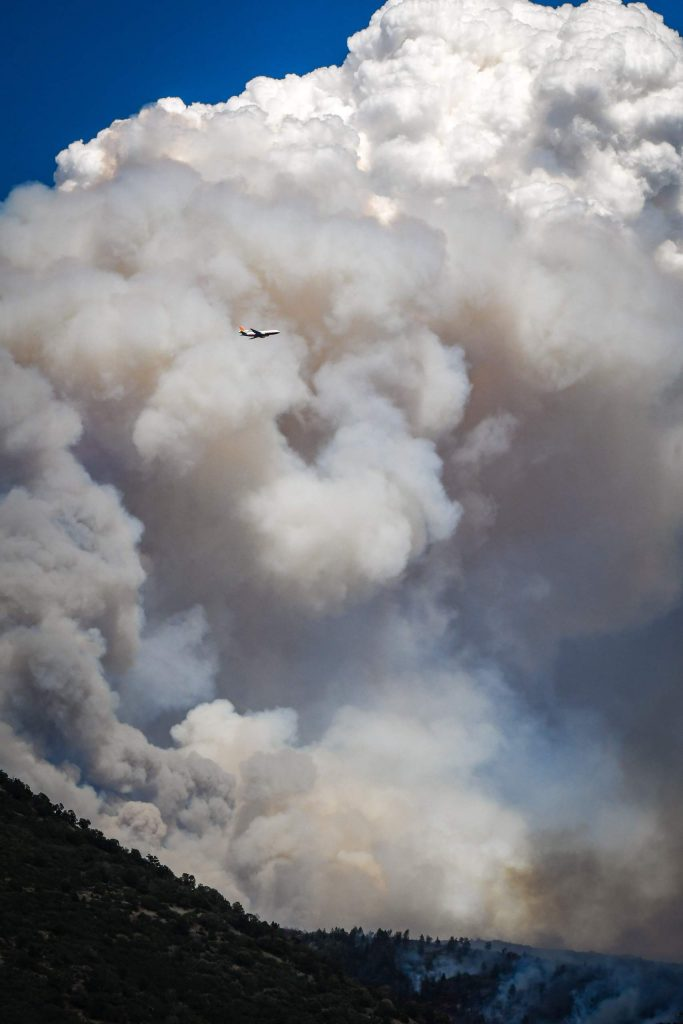 A very large airtanker flies around the plume of smoke billowing from the Grizzly Creek Fire as it blows up in No Name Canyon on Wednesday afternoon.