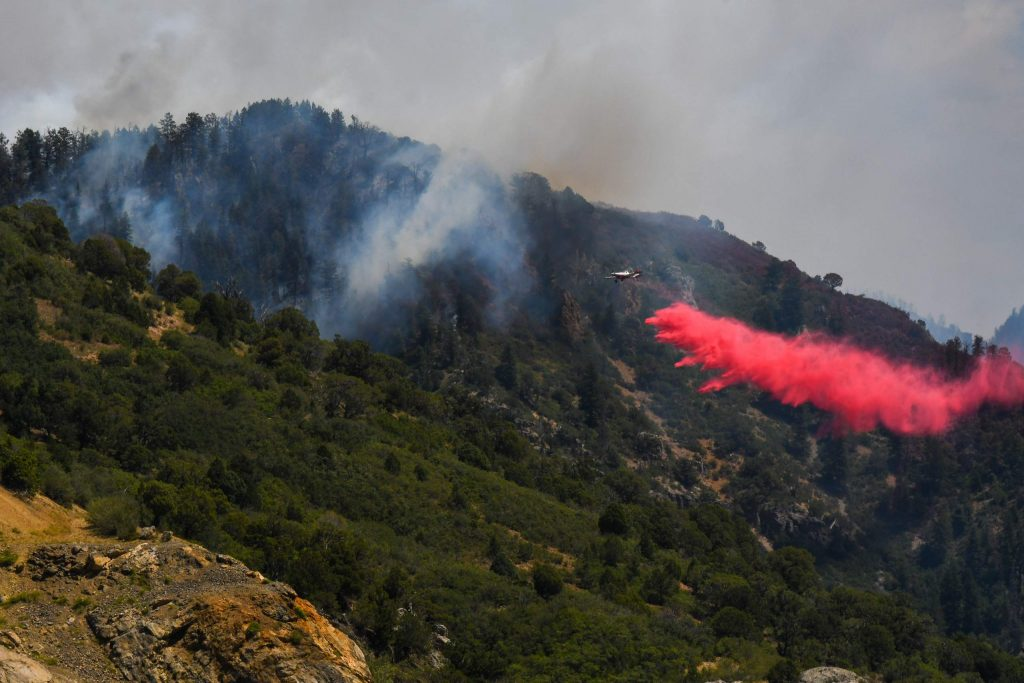 Fire crews work to battle the Grizzly Creek Fire as it shoots down the ridge into No Name Canyon on Tuesday afternoon after the fire initially started on Interstate 70 on Monday at MM 120.