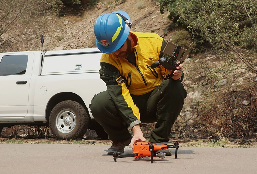 Division Fire Prevention and Control's Ben Miller prepares to launch a drone over the Hanging Lake Trailhead on Sunday.