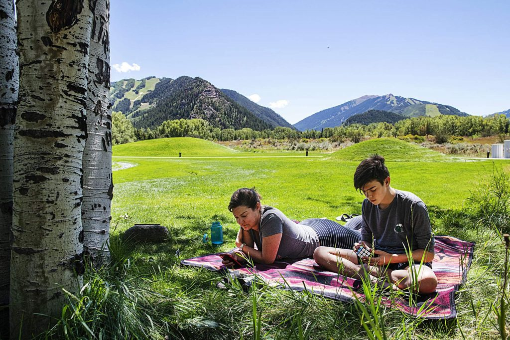 Marcella Abramowicz, left, and her son Ward Abramocwicz, 13, enjoy relaxing at the Aspen Institute on Friday, August 7, 2020. (Kelsey Brunner/The Aspen Times)