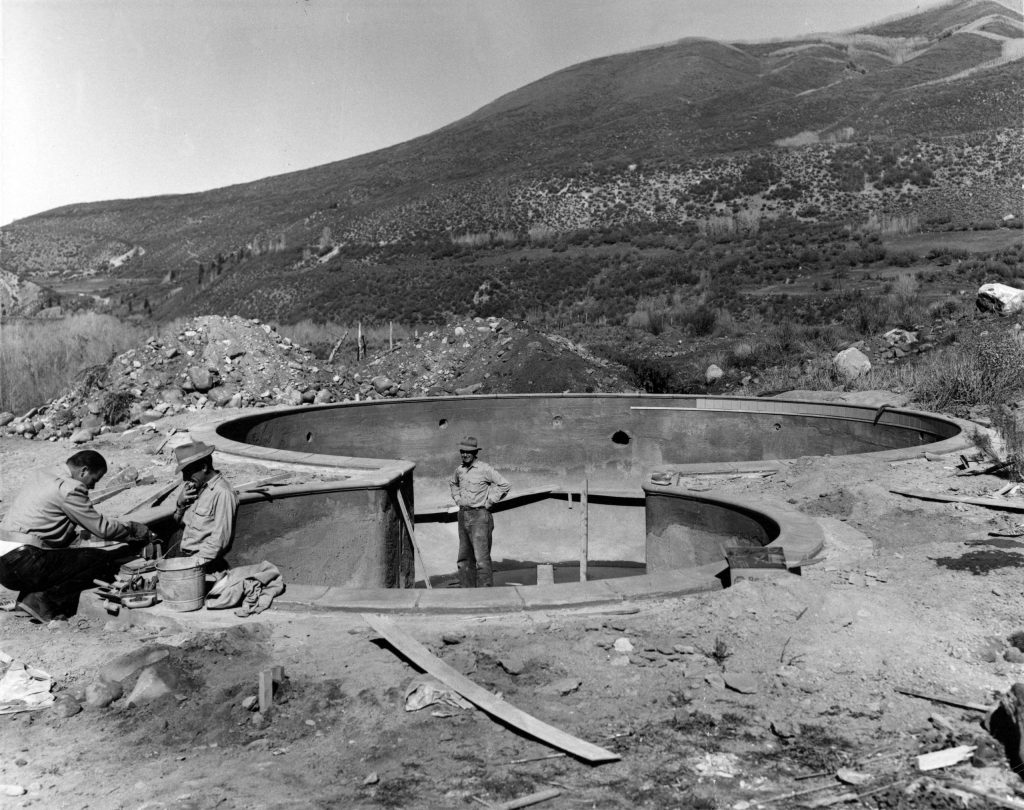 The construction of the pool at the Aspen Meadows, 1955. Red Mountain is visible in the background.