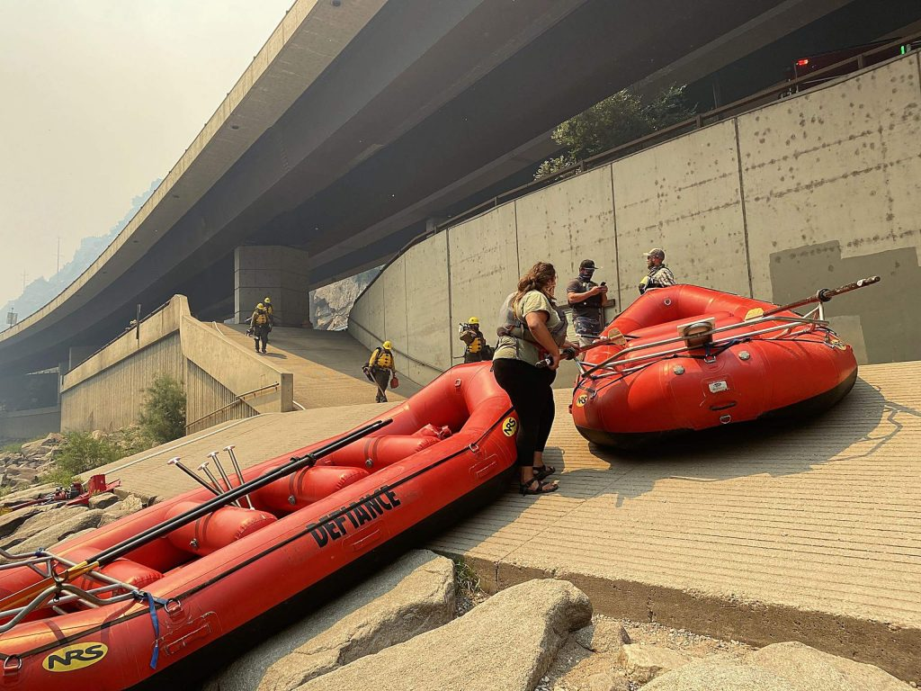 Firefighters and raft guides prepare to embark at the Shoshone boat ramp on Tuesday.