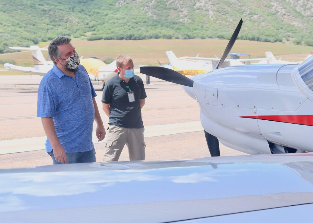 Aspen School District assistant superintendent Tharyn Mulberry checks out one of the Aspen Flight Academy's new Diamond DA40 NG aircrafts on Tuesday, July 28, 2020, at the Aspen/Pitkin County Airport. (Photo by Austin Colbert/The Aspen Times)