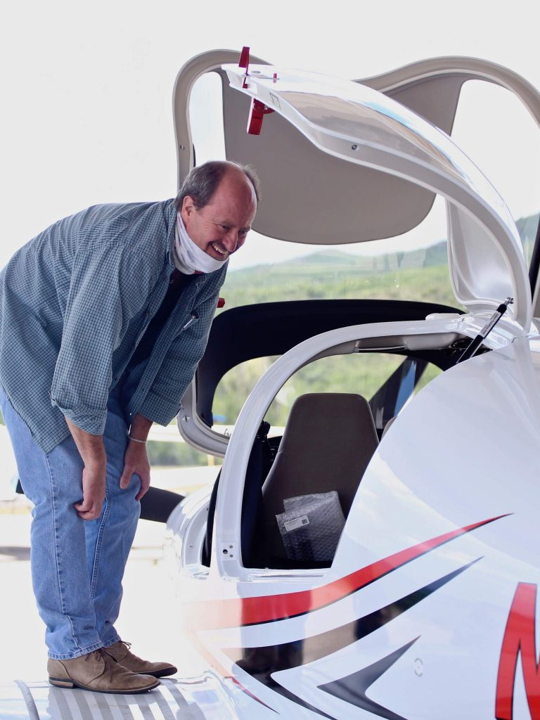 Aspen School District superintendent David Baugh scopes out the Aspen Flight School's new Diamond DA40 NG aircraft on Tuesday, July 28, 2020, at the Aspen/Pitkin County Airport. (Photo by Austin Colbert/The Aspen Times)