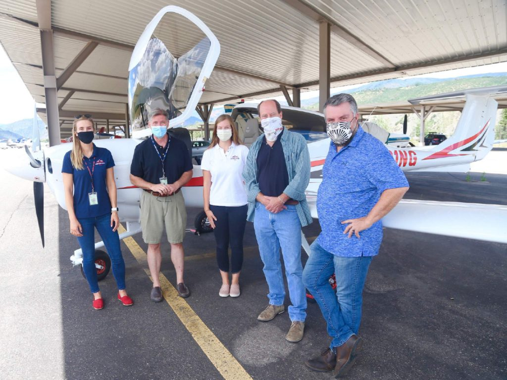 Members of the Aspen Flight Academy stand with Aspen School District superintendent David Baugh and assistant superintendent Tharyn Mulberry in front of the school's new Diamond DA40 NG aircraft on Tuesday, July 28, 2020, at the Aspen/Pitkin County Airport. (Photo by Austin Colbert/The Aspen Times)