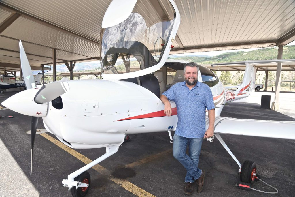 Aspen School District assistant superintendent Tharyn Mulberry stands with one of the Aspen Flight Academy's new Diamond DA40 NG aircrafts on Tuesday, July 28, 2020, at the Aspen/Pitkin County Airport. (Photo by Austin Colbert/The Aspen Times)