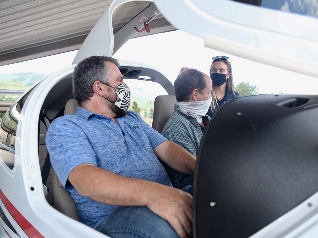 New Aspen School District superintendent David Baugh, right, and new assistant superintendent Tharyn Mulberry sit in the cockpit and talk with lead flight instructor Kate Short about the Aspen Flight Academy's new Diamond DA40 NG aircraft on Tuesday, July 28, 2020, at the Aspen/Pitkin County Airport. (Photo by Austin Colbert/The Aspen Times)