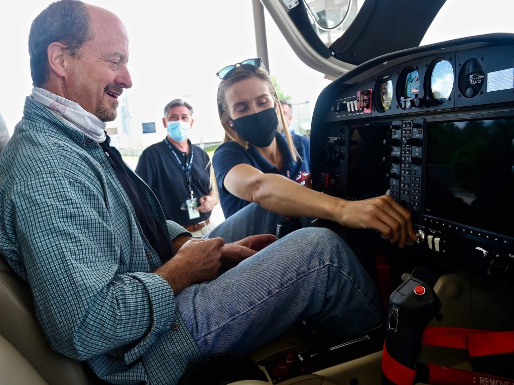 Kate Short, the director of aviation for the Aspen Flight School, shows new Aspen School District superintendent David Baugh the cockpit of their new Diamond DA40 NG aircraft on Tuesday, July 28, 2020, at the Aspen/Pitkin County Airport. (Photo by Austin Colbert/The Aspen Times)