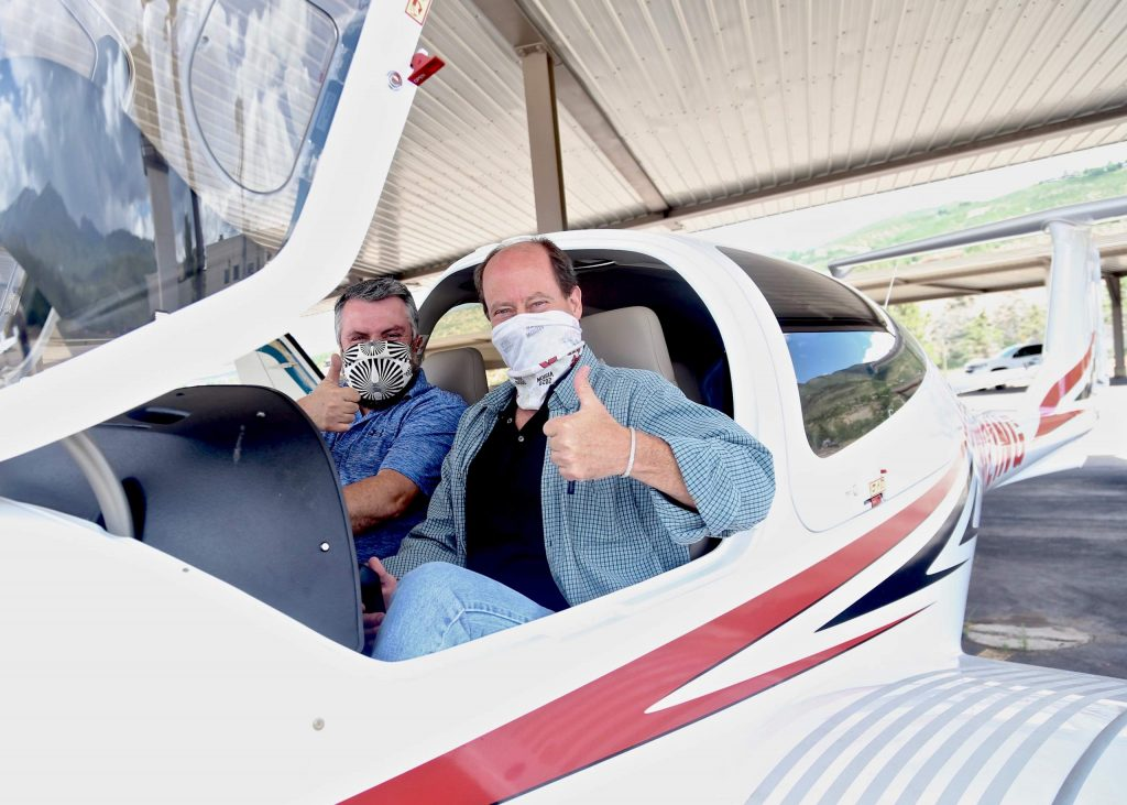 New Aspen School District superintendent David Baugh, right, and new assistant superintendent Tharyn Mulberry sit in the cockpit of the Aspen Flight Academy's new Diamond DA40 NG aircraft on Tuesday, July 28, 2020, at the Aspen/Pitkin County Airport. (Photo by Austin Colbert/The Aspen Times)