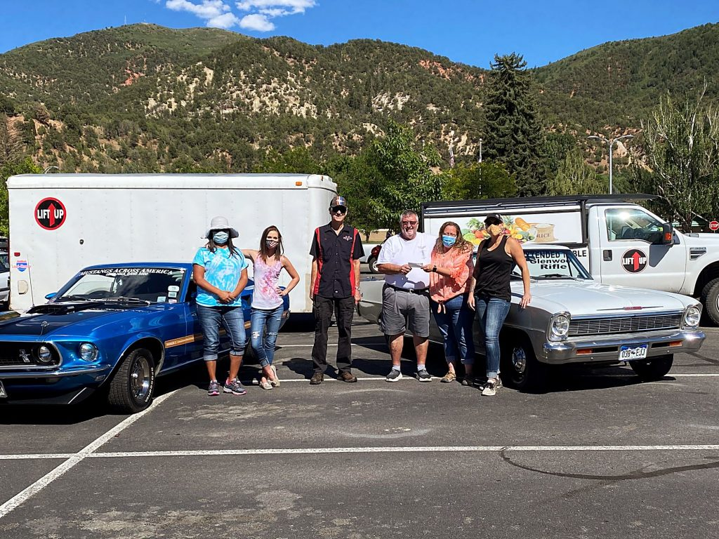 Bart Victor from Vicco's Charcoal Burger Drive-Inn and Ron Madden from Valley Cruisers donates proceeds from their annual car to LIFT-UP prior to Glenwood Springs Food Distribution. Pictured left to right are: Monica Mull (LIFT-UP staff), Kamira Trent (volunteer), Ron Madden (Valley Cruisers), Bart Victor (Vicco's Charcoal Burger Drive-In & Valley Cruisers), Shawn Hampton (LIFT-UP Thrift Store manager), Kelly Williams (LIFT-UP staff)