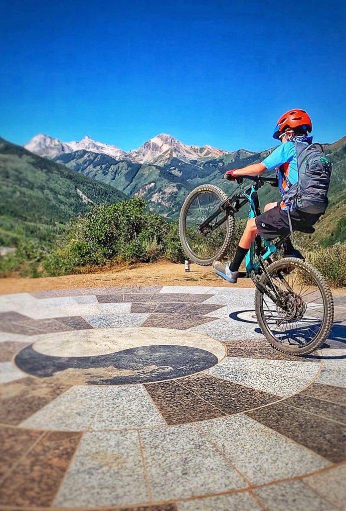Snowmass Village resident Gavin Vold, 11, at the top of the Rim Trail, shows off his wheelie skills on Aug. 7.