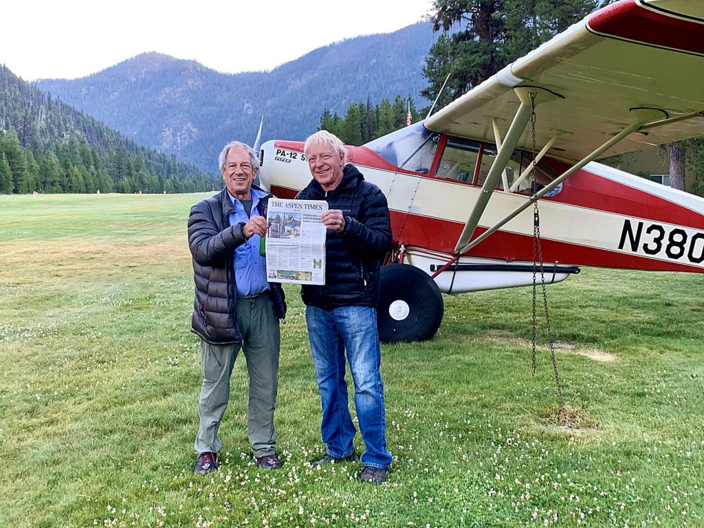 Bruce Gordon and George Gordon, not related but good friends and both pilots based in Aspen, found each other at Johnson Creek, a beautiful backcountry airstrip in Idaho. They are pictured in front of George's Piper PA-12 Super Cruiser. Bruce flew into the strip in his Cessna 210.