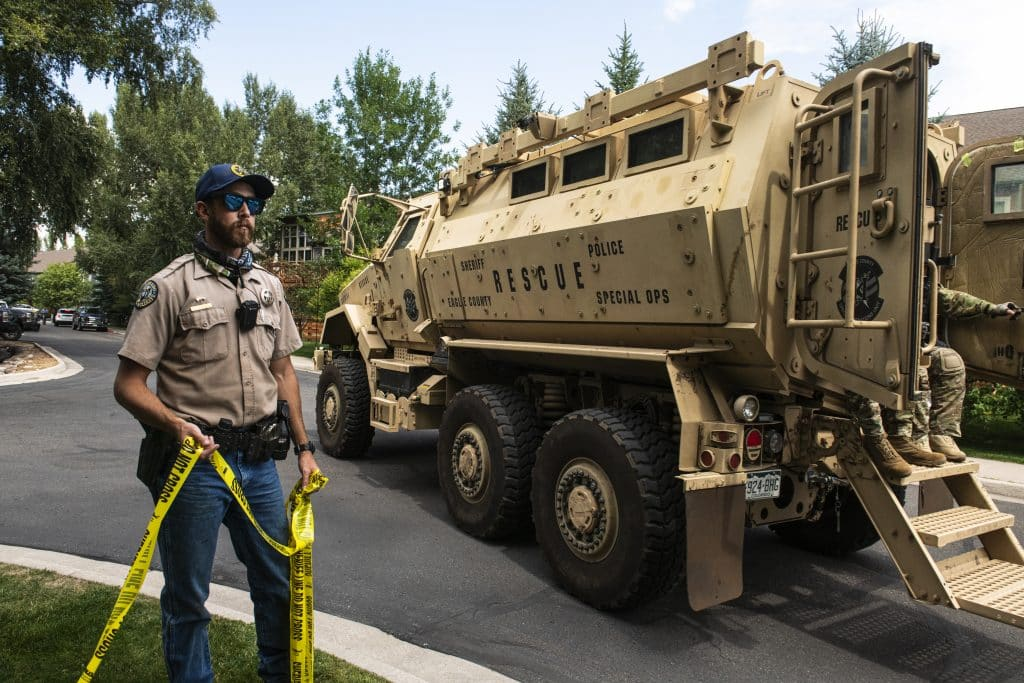 Colorado Parks and Wildlife district wildlife manager Peter Boyatt moves police tape aside as Eagle County's Special Operations Unit vehicle moves on scene in Basalt on Thursday, August 27, 2020.