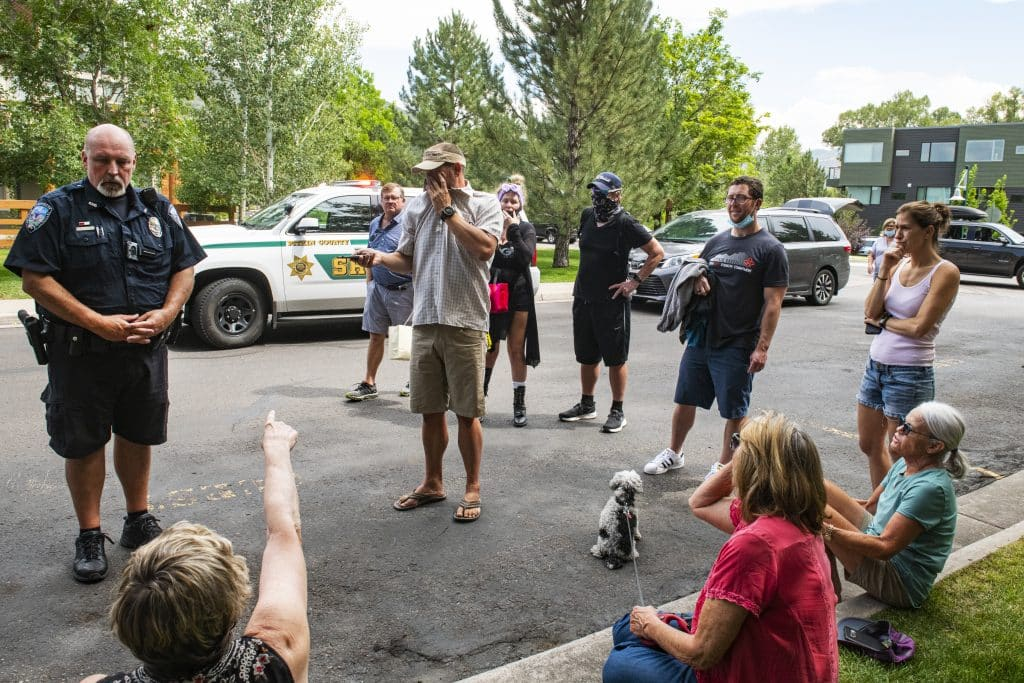 Basalt Police Chief Greg Knott, left, updates evacuated residents with information on the last person inside of the Evans Court unit in Basalt on Thursday, August 27, 2020.