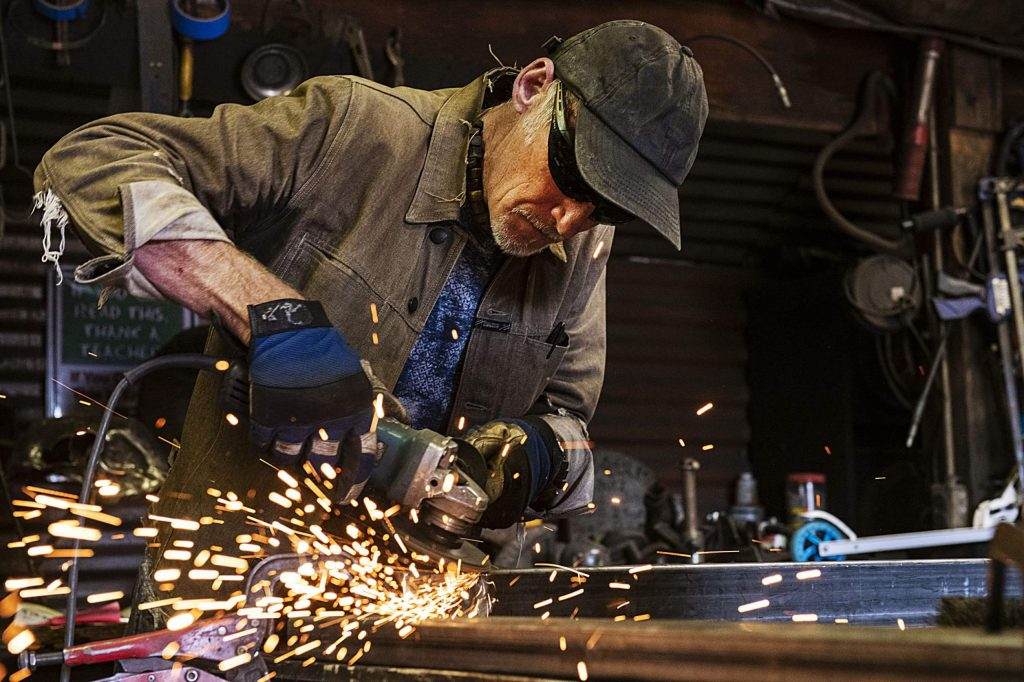 Thomas Barlow works on a gate in the Iron Arts Shop in El Jebel on Wednesdsay, August 12, 2020. (Kelsey Brunner/The Aspen Times)