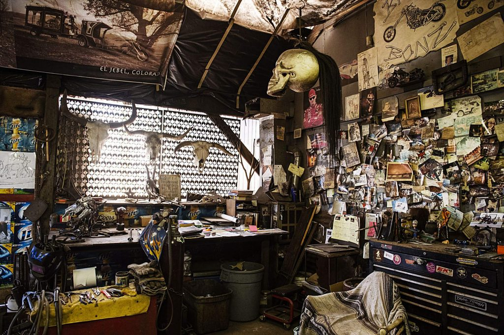 Photographs and skulls decorate an area of the Iron Arts Shop in El Jebel on Wednesday, August 12, 2020. (Kelsey Brunner/The Aspen Times)
