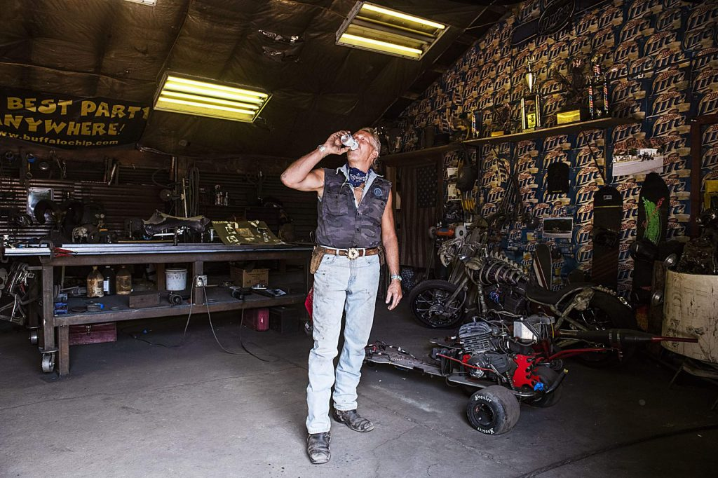 Vaughn Shafer takes a swig of a Miller Lite in his Iron Arts Shop in El Jebel on Wednesday, August 12, 2020. (Kelsey Brunner/The Aspen Times)