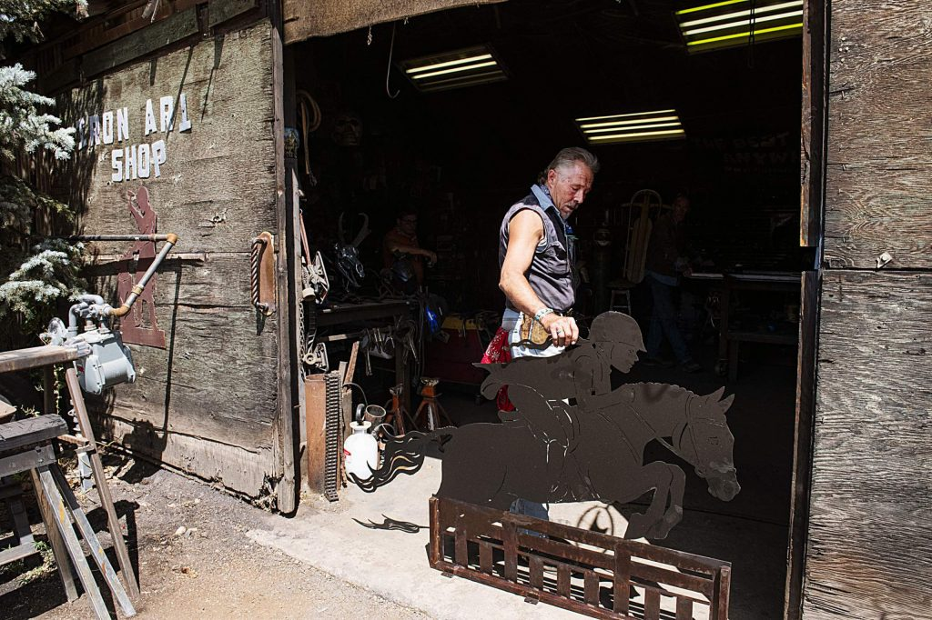 Vaughn Shafer holds a gate topper for a client outside of his Iron Arts Shop in El Jebel on Wednesday, August 12, 2020. (Kelsey Brunner/The Aspen Times)