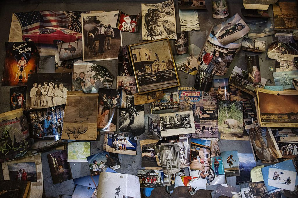 Photographs hang on the wall of the Iron Arts Shop in El Jebel on Wednesday, August 12, 2020. (Kelsey Brunner/The Aspen Times)