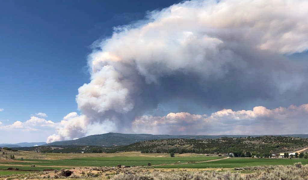 The plume of the wildfire at Bair Ranch in Glenwood Canyon is visible from Missouri Heights Monday afternoon. Midvalley residents were on edge when the plume materialized because the fire seemed much closer to Missouri Heights.