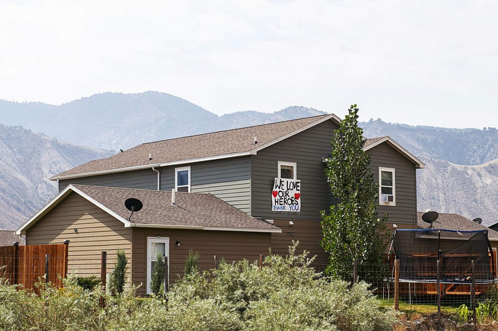 A sign hangs on a home off the I-70 Dotsero exit to show support for firefighters during the Grizzly Creek Fire on Thursday, August 20, 2020. (Kelsey Brunner/The Aspen Times)