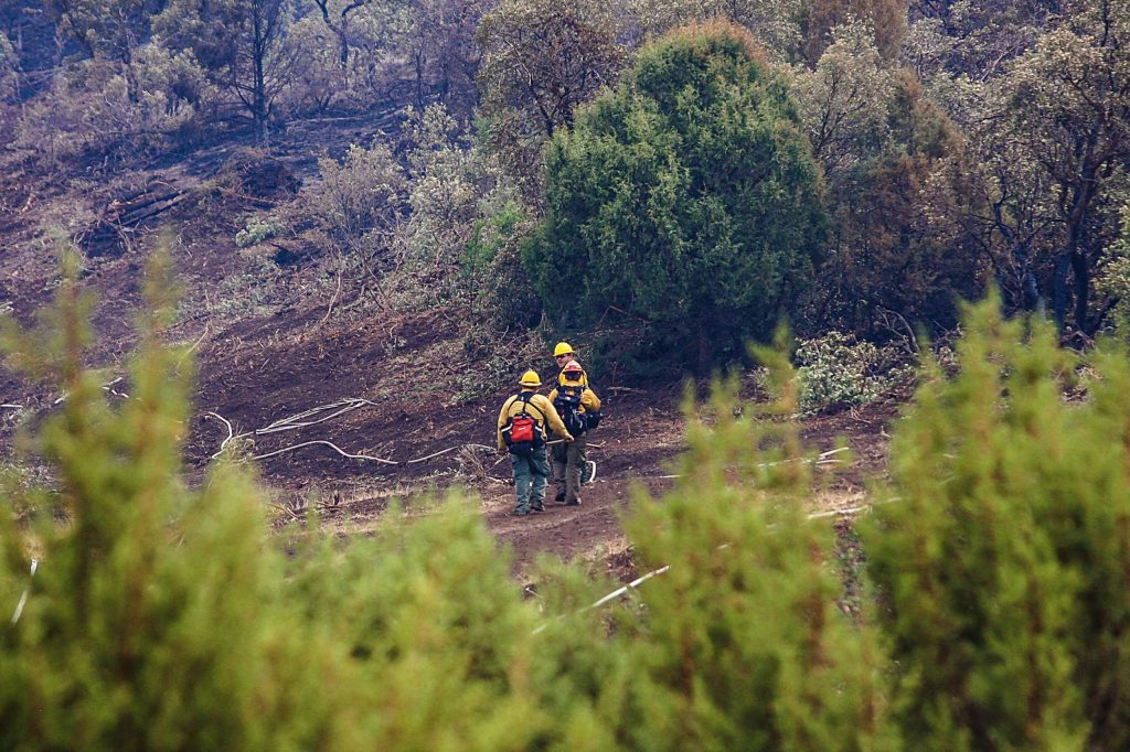 Crews go back to work fighting the Grizzly Creek Fire after sheltering from lighting Thursday above Bair Ranch. No structures have been lost yet.