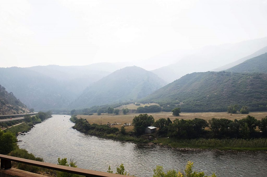Smoke rises from the ridge line as I-70 wraps around the Colorado River outside of Glenwood Springs on Thursday, August 20, 2020. (Kelsey Brunner/The Aspen Times)