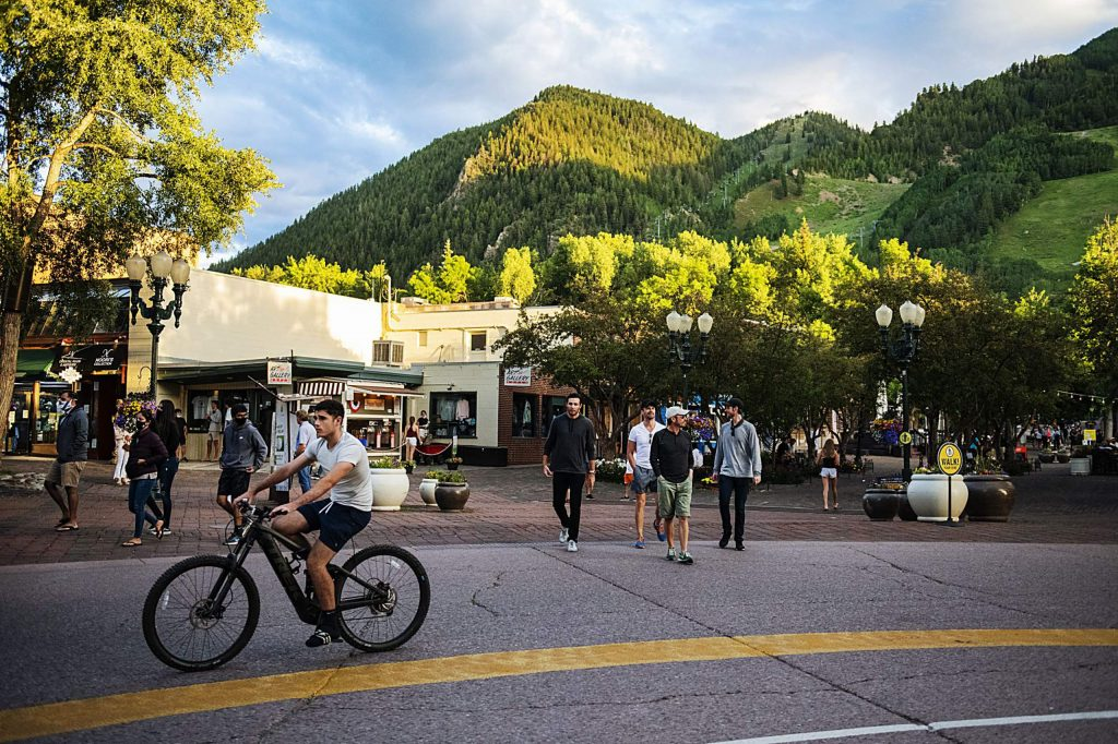 The sun begins to set over downtown Aspen as people enjoy the summer weather on Monday, July 6, 2020.