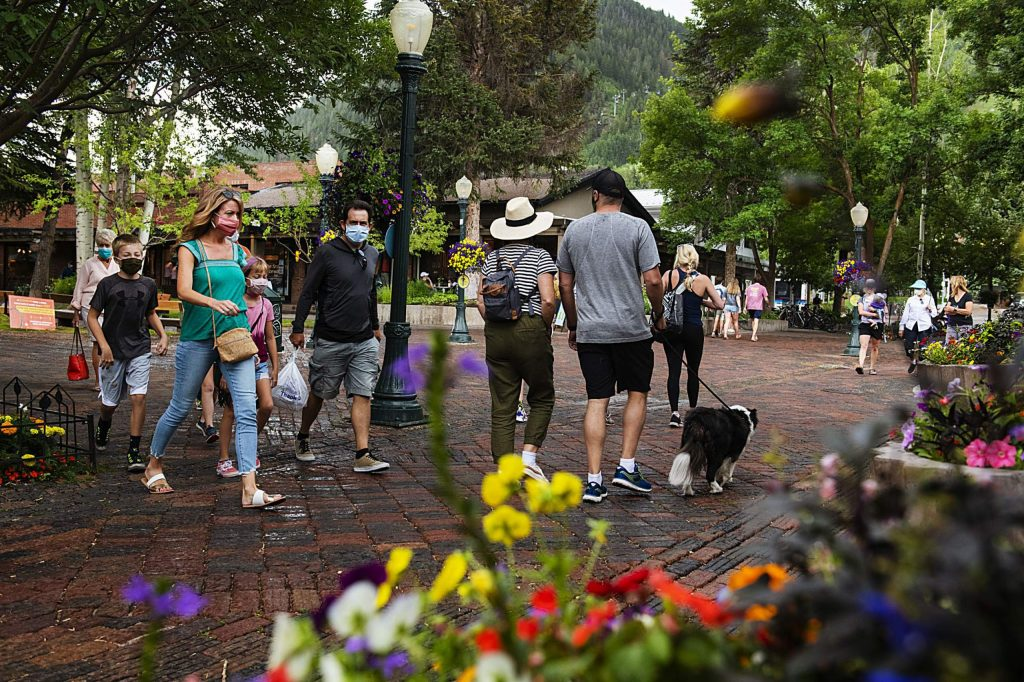 People explore downtown Aspen on Wednesday, July 15, 2020.