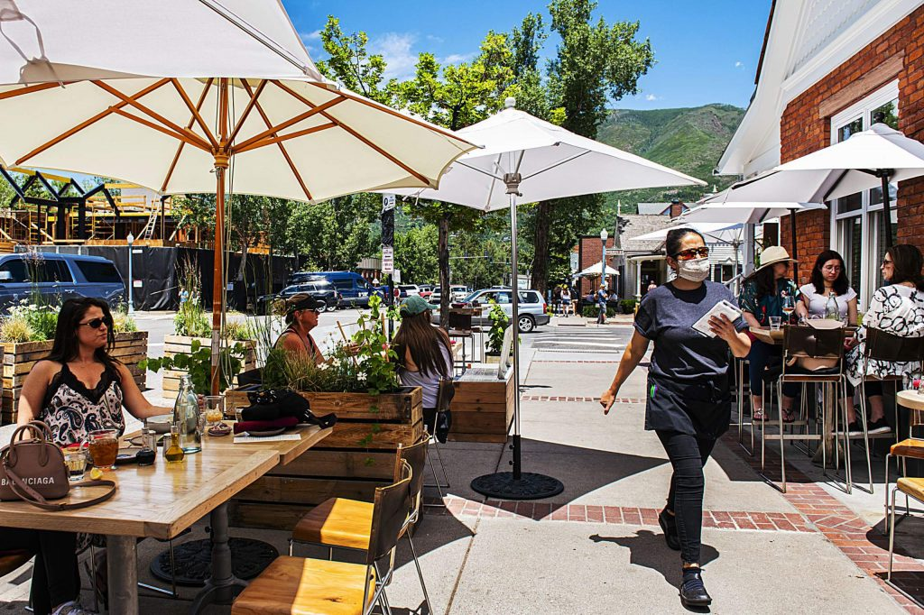 People enjoy an afternoon of outdoor dining at Bear Den Aspen on Friday, June 26, 2020.