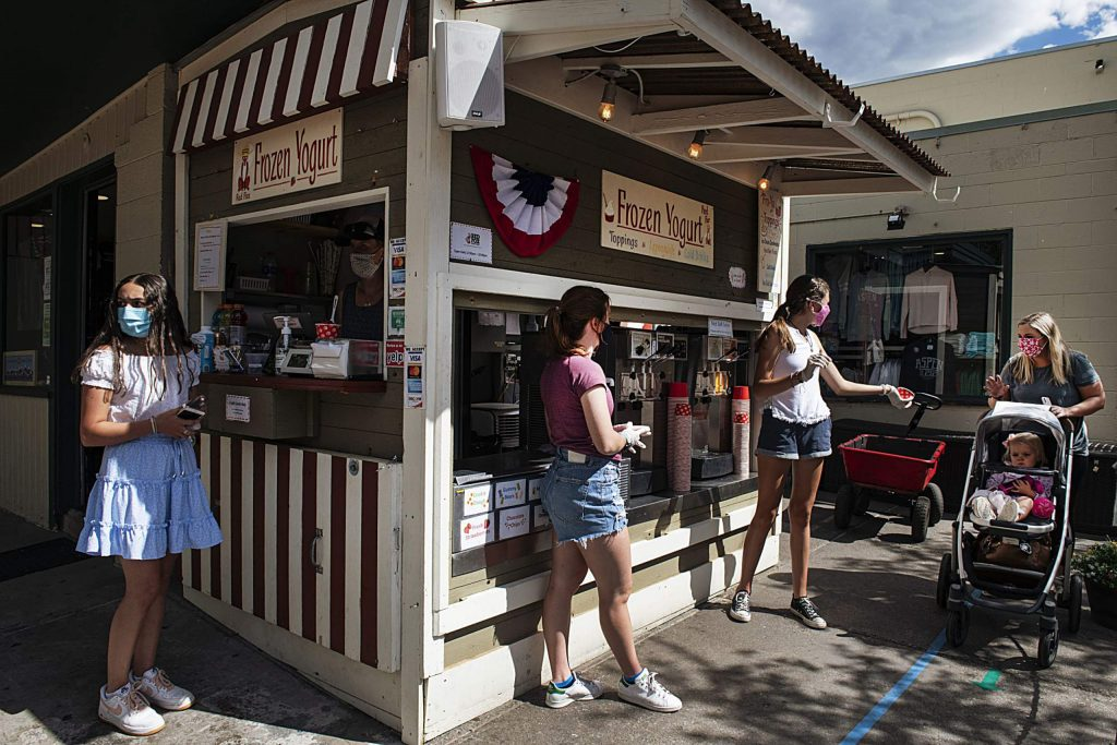 People get served frozen yogurt at the stand in downtown Aspen on Tuesday, July 7, 2020.