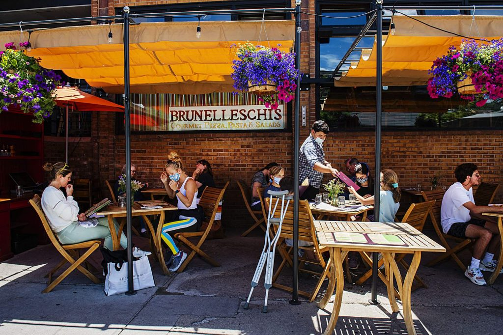 People enjoy patio dining at Brunelleschi's in Aspen on Friday, June 26, 2020.