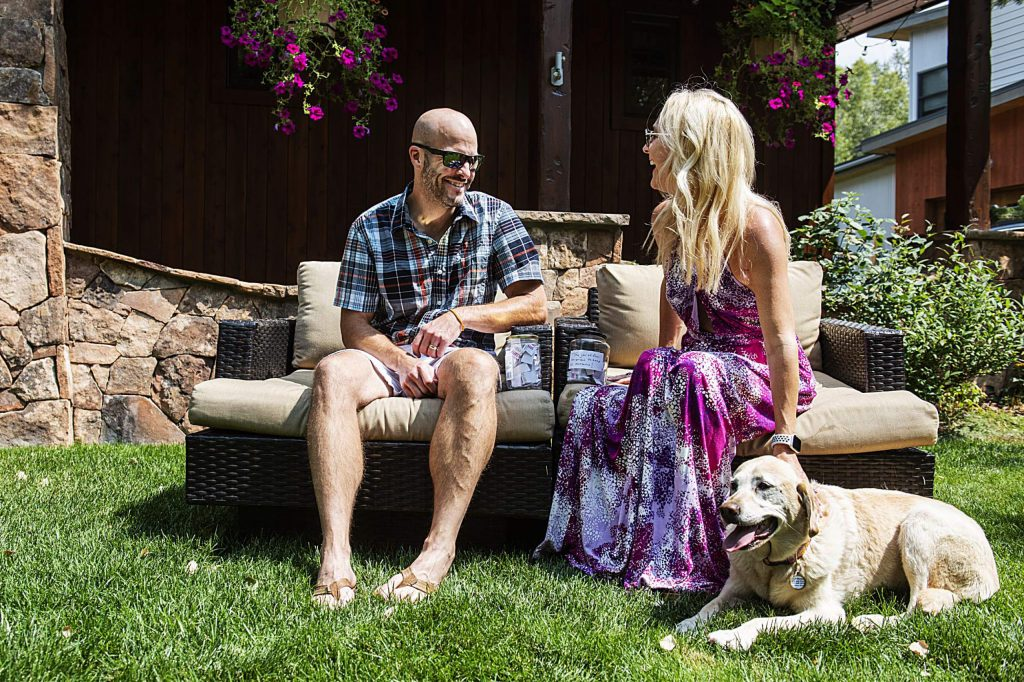 Nick Blastos and Grayson Stover sit in their yard with their dog Lexi at their home in Basalt on Friday, August 21, 2020. (Kelsey Brunner/The Aspen Times)