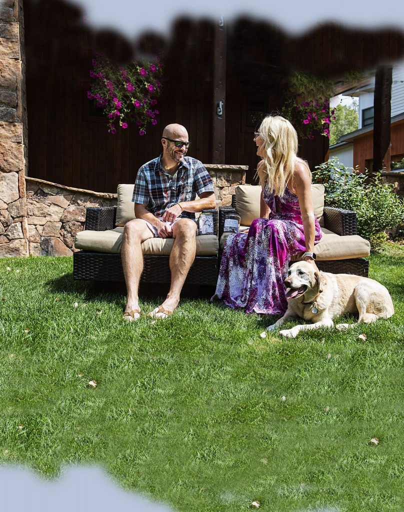 Nick and Grayson stover sit in their yard with their dog Lexi at their home in Basalt on Friday, August 21, 2020. (Kelsey Brunner/The Aspen Times)