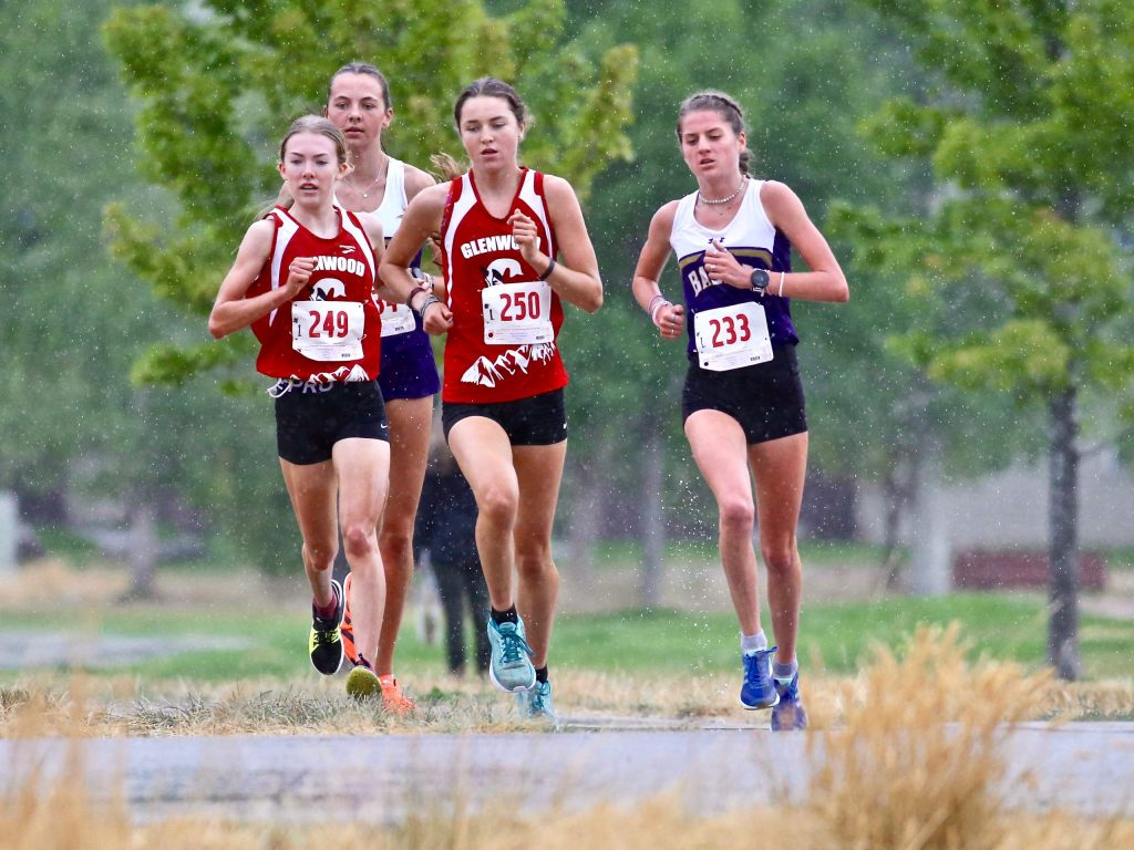 Basalt's Sierra Bower, right, runs with the lead pack during the Longhorn Invitational cross country meet on Saturday, Aug. 29, 2020, at Crown Mountain Park in El Jebel. (Photo by Austin Colbert/The Aspen Times)
