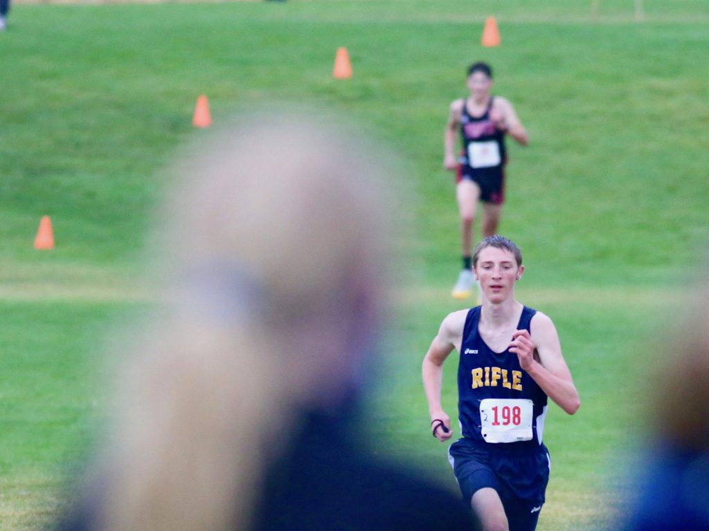 Rifle's Jace Coller competes in the Longhorn Invitational cross country meet on Saturday, Aug. 29, 2020, at Crown Mountain Park in El Jebel. (Photo by Austin Colbert/The Aspen Times)